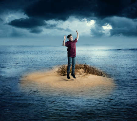 Shipwrecked on a small island shout for help. Stock Photo
