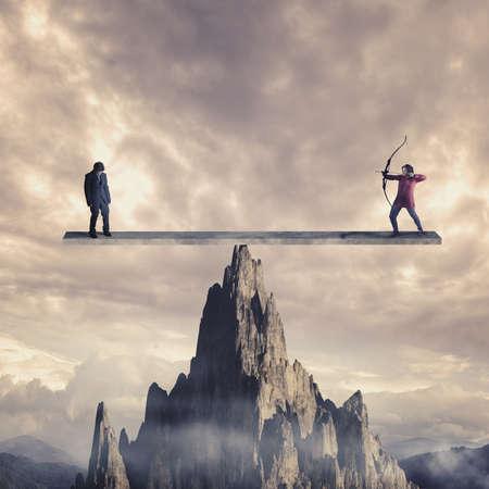 Archer vise à tirer sur un homme faible sur une balance au-dessus d'une montagne. Le concept de karma.