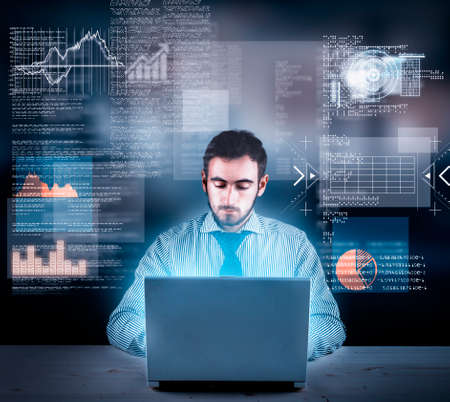 Businessman working on laptop with a futuristic infograph Stock Photo