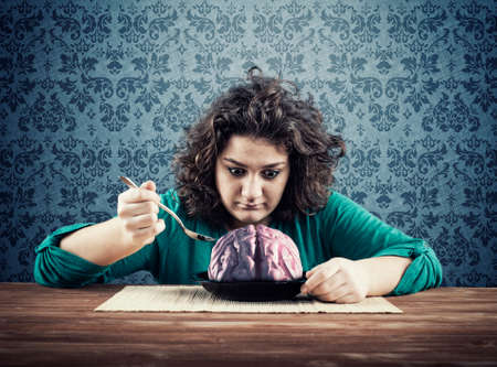 Shocked woman have to eat a brain . The concept of learning very fast.