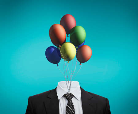 Business suit with colorful balloons in place of head .The concept of positive and calm mind. Corporate party celebration.