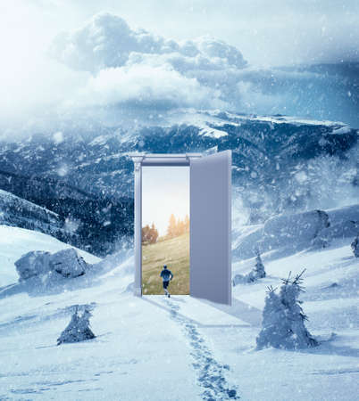 Man running through a door to a warm place at the mountains. The concept of season change.