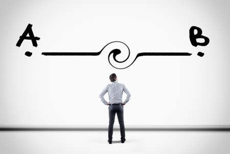 Businessman looking at a line between point a to point b , drawn on a white wall. Stock Photo