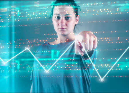 Woman pressing on a touch screen with bytes and a graph . Futuristic user interface. Stock Photo
