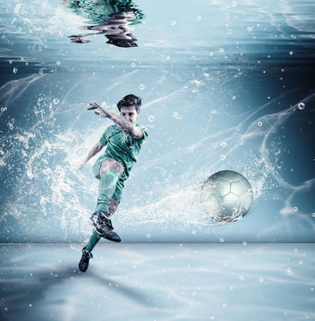 Soccer player shooting the ball at the bottom of a swimming pool. Unreal shoot of the ball underwater.