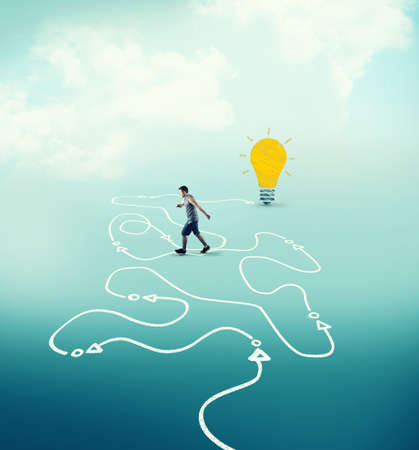 Man following a drawn path to a lightbulb. The concept of achieving success.