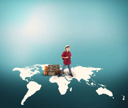Young traveller standing on world map with luggages. The concept of travel booking. Standard-Bild
