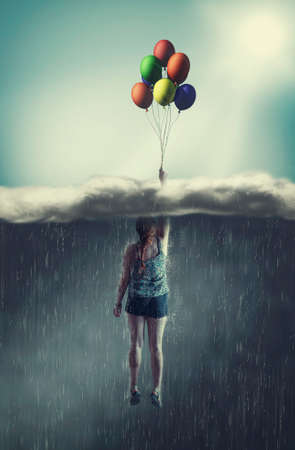 Woman flying with balloons through a rainy cloud to the sunny sky. The concept of overcoming fears. Banque d'images - 117978070