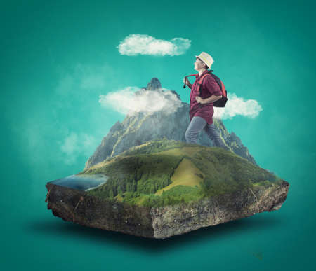 Young traveller walking through mountains . Travel and vacation concept. Cube of a mountain enviroment. Stock Photo