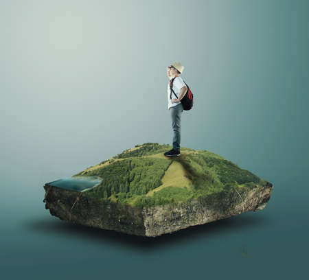 Young traveller standing on a cube of a plain . Travel and vacation concept. Pair of earth isolated. Stock Photo