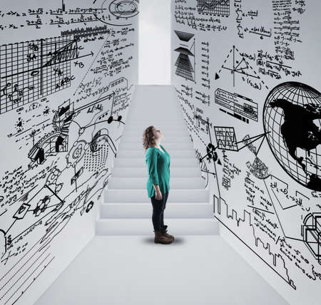Woman  in a hallway drawn with math formulas and stairway to lightbulb .
