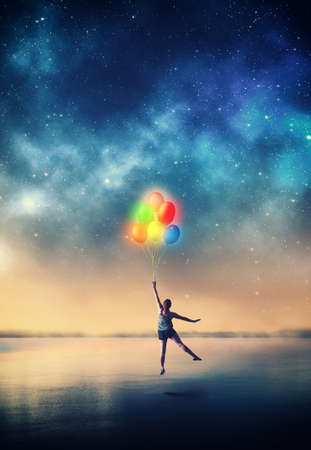 Woman flying with balloons to the space. Stock Photo