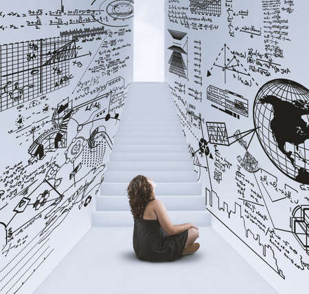 Woman sitting in a hallway drawn with math formulas and stairway to lightbulb .