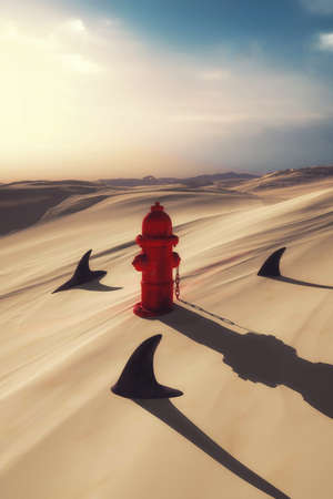 Hydrant in the desert surrounded by sharks Stock Photo