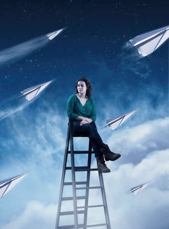Woman sittin on a ladder above clouds at night, paper airplanes fly up.