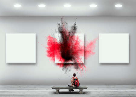 Teenager sitting on a bench in a white room looking at different square - colorful powder . Out of the box concept