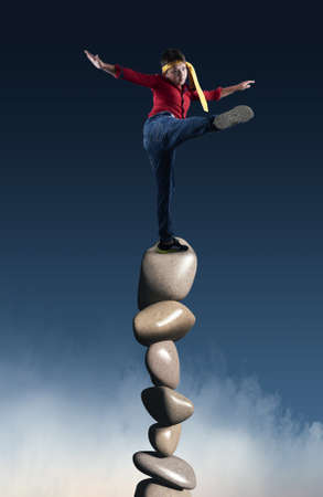 Man balancing on a stack of stones.