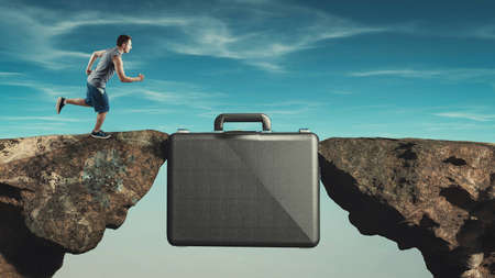 Man running on a suitcase between two rocks. Internship concept.