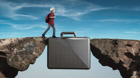 Kid running on a suitcase between two rocks. Internship concept.