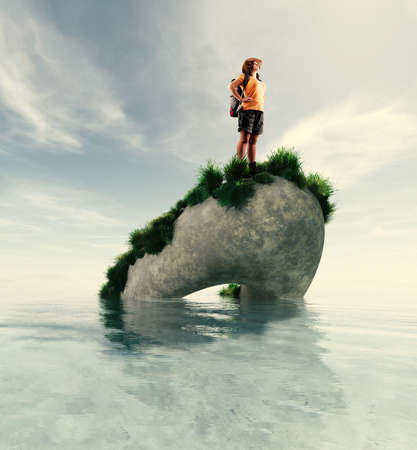 Traveler on a big rock in the middle of the ocean
