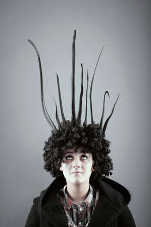 Woman with her hair rising up. Creative mind concept.