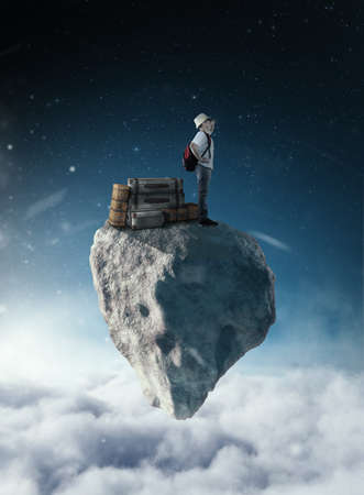 Traveler with luggages on a rock above clouds.