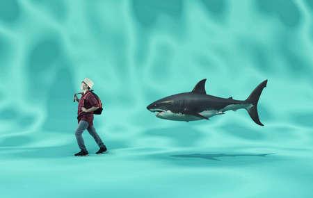 Kid walks with joy followed by a shark. The concept of facing fears. 版權商用圖片