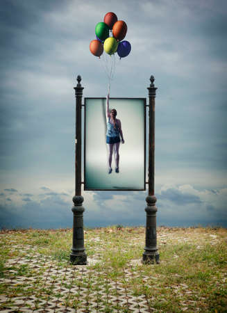 Billboard of a woman flying away with balloons.