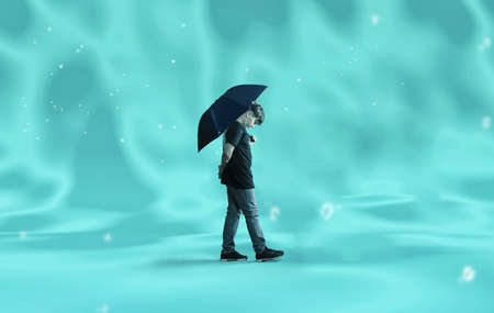 Person walks and holding an umbrella underwater.