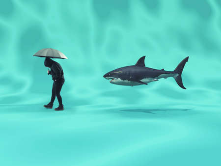 Person walks underwater holding an umbrella and followed by a shark.