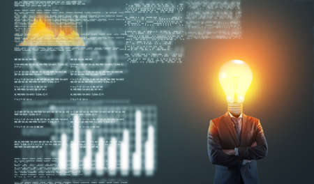 Businessman with a lightbulb instead of head in front of futusrtic data and information codes. .  Banco de Imagens