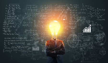 Businessman with a lightbulb instead of head in front of math formulas .