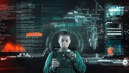 Woman working futuristic user interface . High tech screens data and information . Foto de archivo