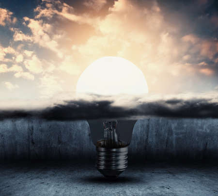 Half light bulb under cloud and other half outside and illuminated . Positive mindeset and success concept .