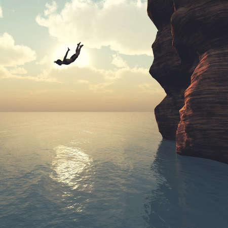 Man jumping from a tropical cliff in the ocean .