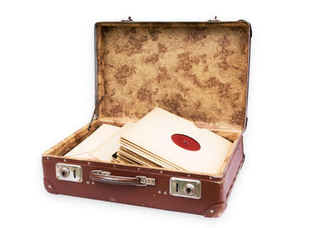 Old worn suitcase filled with old records Stock Photo