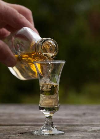 Pour Liqueur into a glass photo