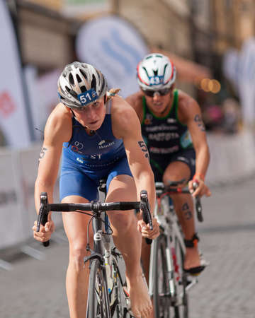 est: STOCKHOLM - AUG, 23:  World Triathlon  event Aug 23, 2014. woman bikes in Old town, Stockholm, Sweden. Kaidi Kivioja, EST.