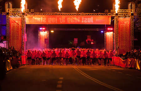 verb: STOCKHOLM - AUG, 16: Seconds after the start of the Midnight Run (Midnattsloppet) event. Aug 16, 2014 in Stockholm, Sweden Editorial