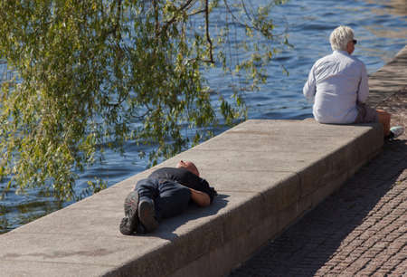 sweden resting: Stockholm Sweden on September 3 2014 Two men resting on the stone wall in the center of Stockholm. Editorial