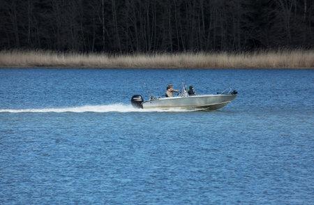 rapid steel: TULLGARN SWEDEN, 7 april 2015. fishermen in motorboat