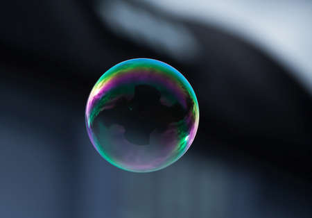 bubble: A flying soap bubble with reflection of a building.