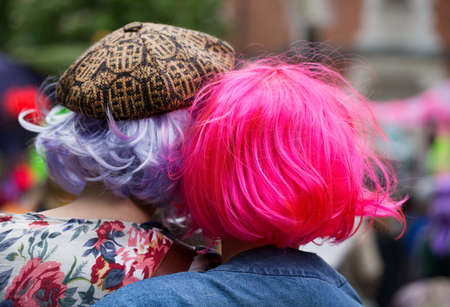 wigs:  Street party in Stockholm. Women in wigs with bright colors. Stock Photo