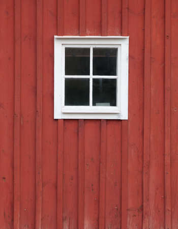 typical: Painted house wall with typical Swedish Falun red paint.