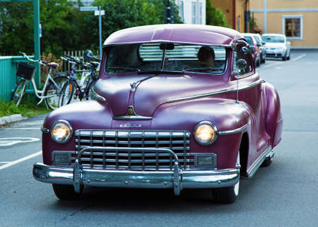 dodge: TROSA SWEDEN, 16 JULI 2015. An old Purple Dodge driving in the small town of Trosa in Sweden.