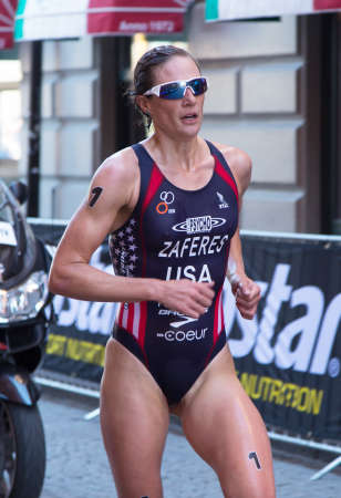 silver medal: STOCKHOLM - AUG 22: Women ITU World Triathlon event Aug 22 2015. Woman running in Old town. Zaferes Katie USA. Silver medal,