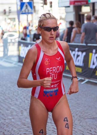 peron: STOCKHOLM - AUG 22: Women ITU World Triathlon event Aug 22 2015. Woman running in Old town. Peron Gaia