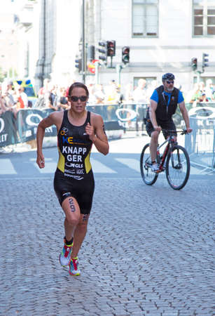 anja: STOCKHOLM - AUG 22: Women ITU World Triathlon event Aug 22 2015. Woman running in Old town. Knapp Anja (GER). Editorial