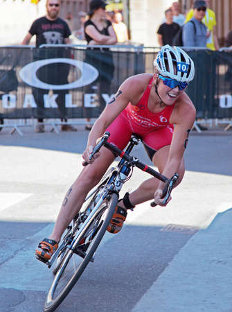ber: STOCKHOLM - AUG 22: Women ITU World Triathlon event Aug 22 2015. Woman cycling in Old town. Duffy, Flora (BER).