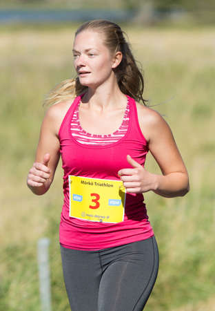 exerted: MORKO SWEDEN - AUG 29 2015: Triathlon for both exercisers and professional exerted on August 29 on an island in Sweden.
